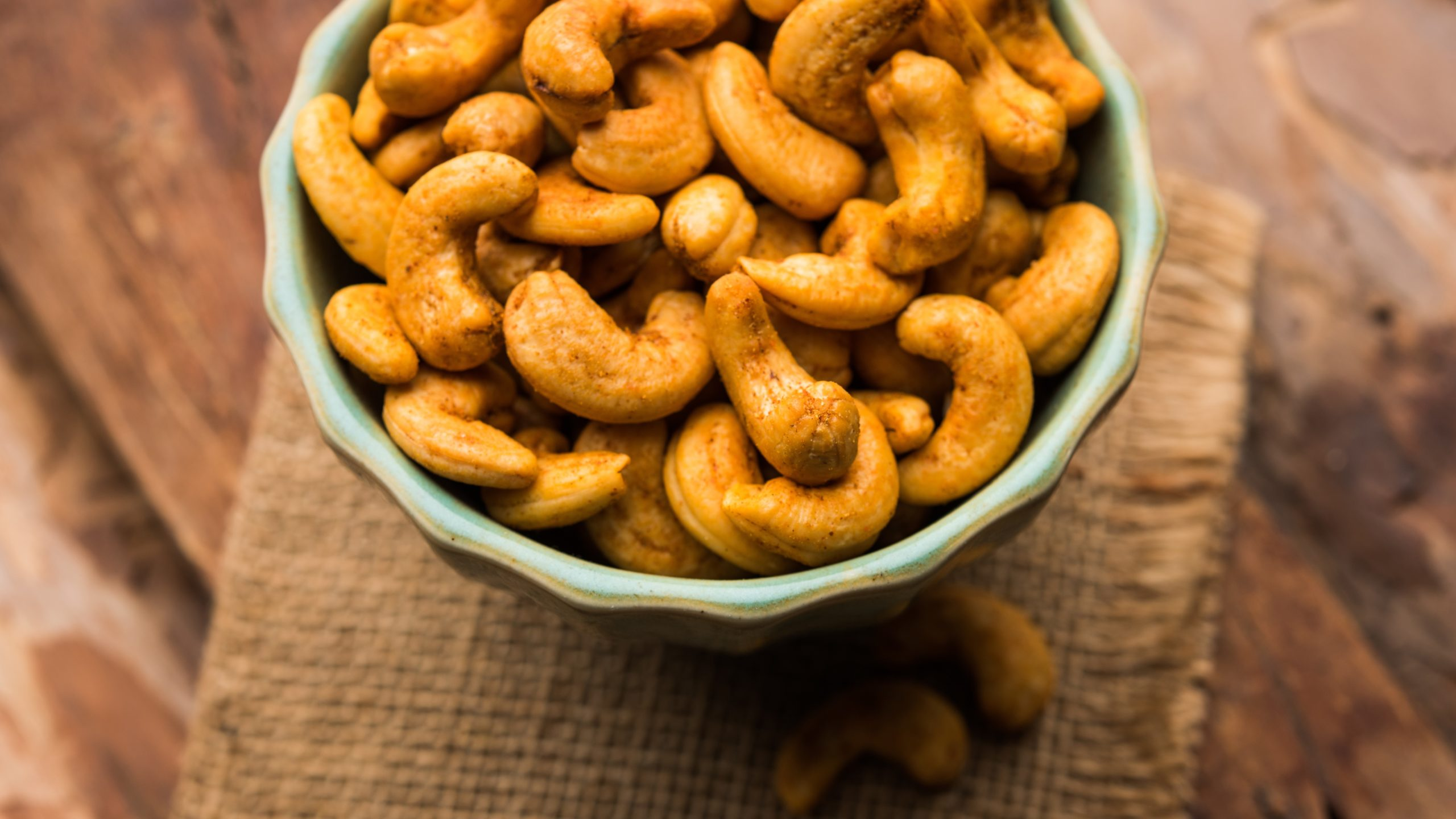 Masala Kaju or spicy Cashew in a bowl. Popular festival snack from India/asia, also known as Chakna recipe