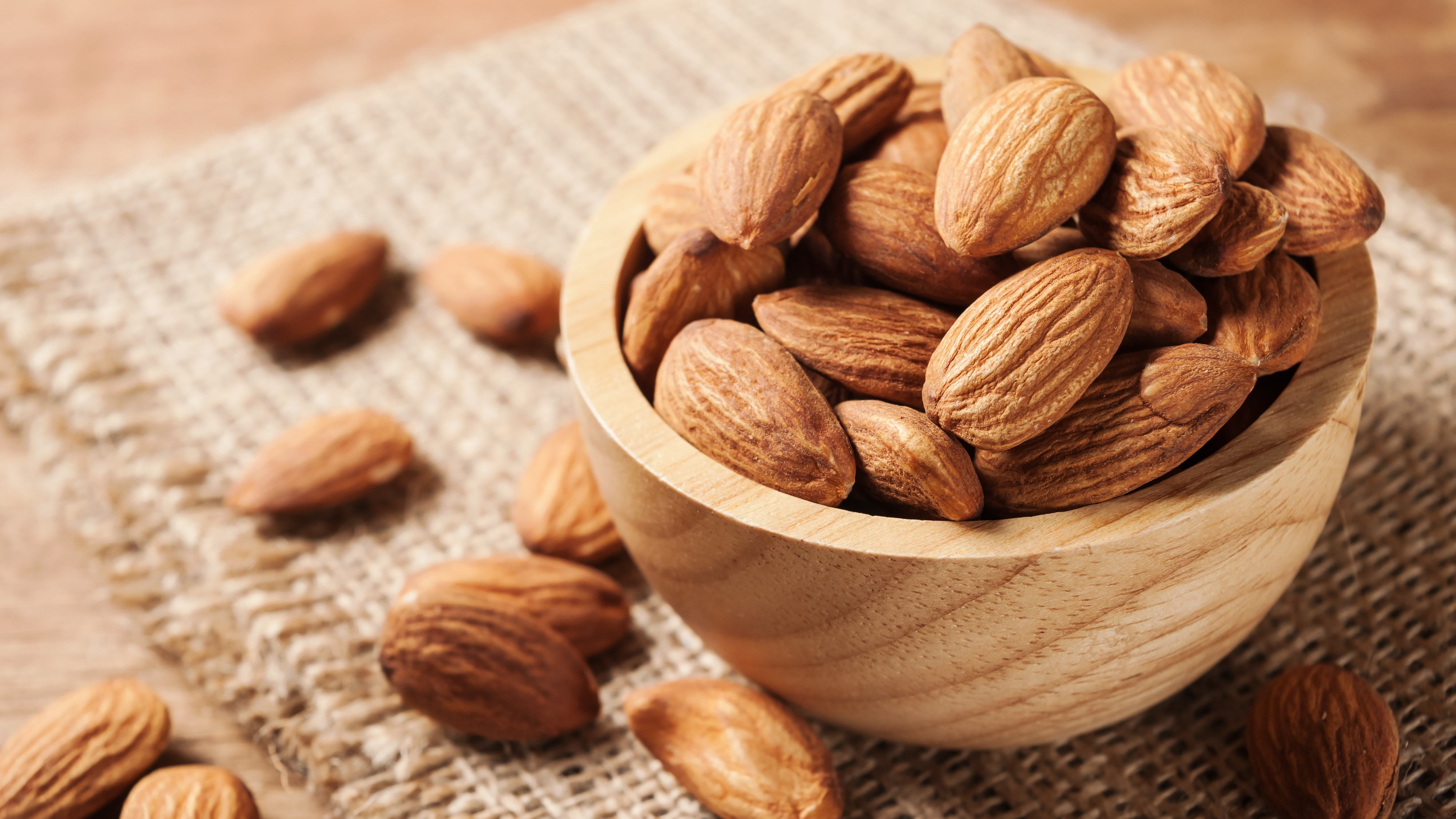 Almond snack fruit in wooden bowl