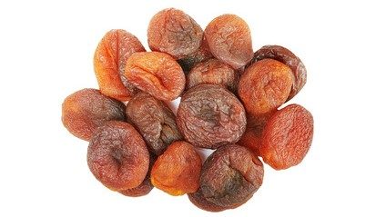 Close up picture of dried organic apricots isolated on white bac