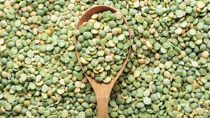 uncooked peas is scattered background